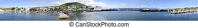 Husavik Harbor Panorama - The arctic harbor of Husavik along...