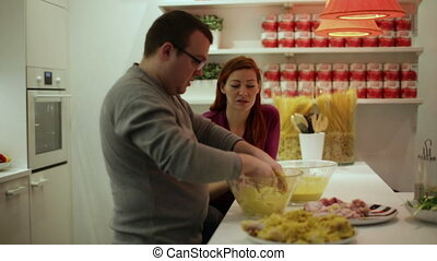 Husband and wife at kitchen table preparing dinner