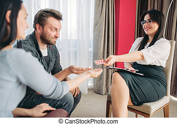 Husband and wife at psychologist reception, stress