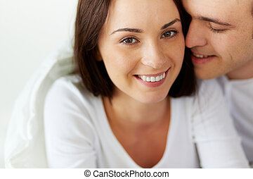 Husband and wife - Portrait of smiling female looking at...