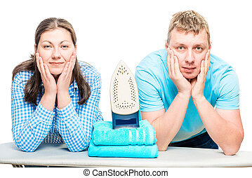 husband and wife posing on ironing board with iron, shooting on white background