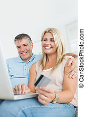 Husband and wife shopping online wi