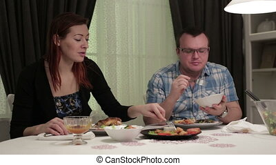 Husband and wife sitting at dinner table in a cafe