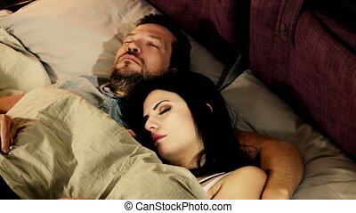 husband and wife sleeping in bed