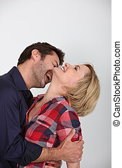 Husband biting neck