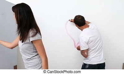 Husband drawing a heart on the wall