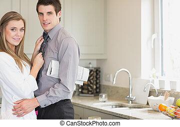 Husband embracing wife