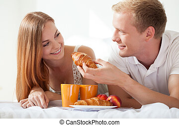 Husband feeding his wife