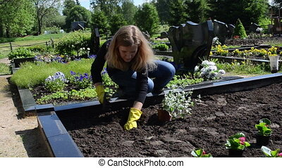 husband grave plant - Woman girl wife sit plants and flowers...