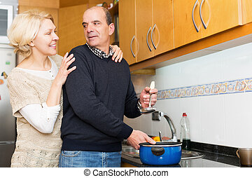 Husband helping wife to cook