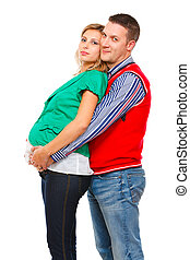 Husband hugging her pregnant wife on white background