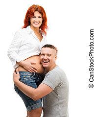 Husband hugs his pregnant wife