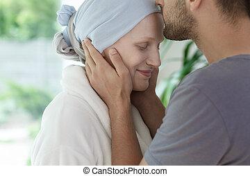 Husband kissing his wife