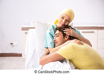 Husband looking after wife in hospital