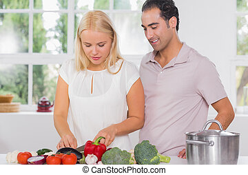 Husband looking at his wife cooking