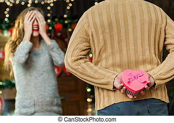 husband making surprise to his wife on valentine's day