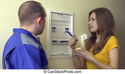 husband man explain his wife woman  how to use circuit breaker box at home