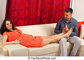 Husband massage pregnant wife - Husband massaging his...