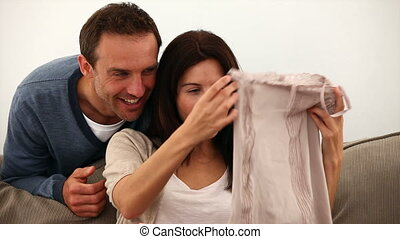 Husband offering his wife a top