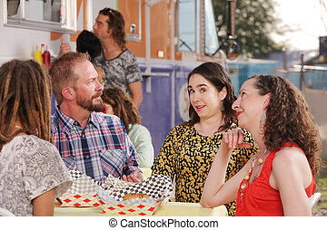 Husband questions wife during lunch with friends