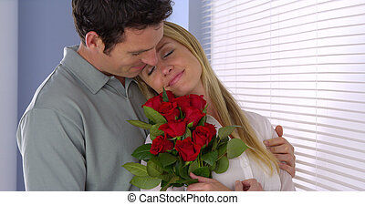 Husband surprises his wife with flowers