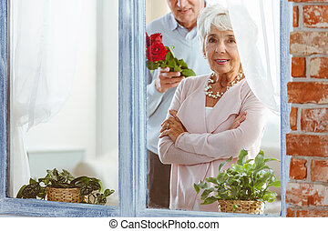 Husband surprising his wife