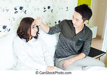 husband taking care of sick wife