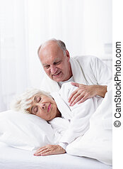 Husband waking up her wife