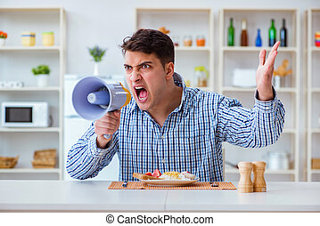 Husband with loudspeaker yelling at his wife