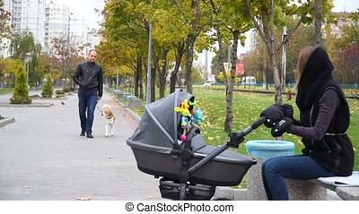 Husband with the dog coming to his wife with a child