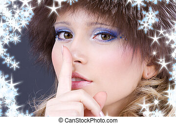 hush - portrait of beautiful woman with finger on lips