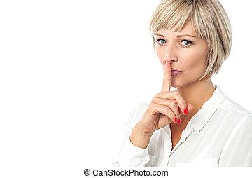Hush...Silence please! - Pretty calm woman gesturing silence