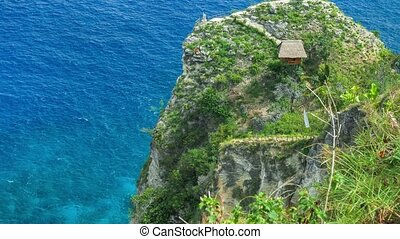 Hut and View point on the cliff edge in the North Coast of Nusa Penida, Bali, Indonesia