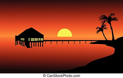 Hut in beach landscape at the sunset with sun