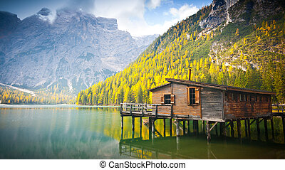 Hut on Braies lake in autumn