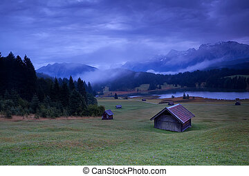 hut on meadows by Geroldsee lake