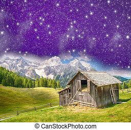 Hut on mountain landscape at night