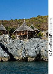 hut on the cliff near the sea