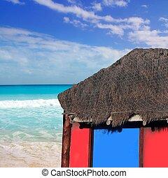 hut palapa in beach turquoise caribbean blue sky
