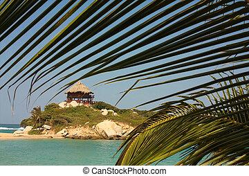 Hut with hammocks on a Caribbean beach. Tayrona National Park. Colombia.