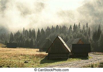 Huts along the trail at dawn