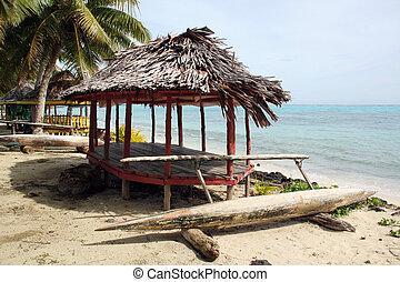 Huts and boat on the sand beach in Savaii, Samoa