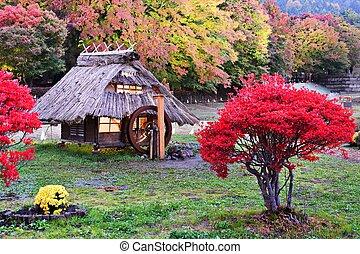 Huts and fall foliage in Kawaguchi, Japan.
