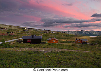 Huts in landscape of Norway sunset