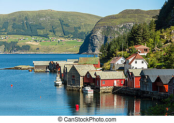 Red wooden fishing cabins in Norway