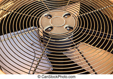 HVAC Condenser Fan Close Up - Condenser fan above coiling...