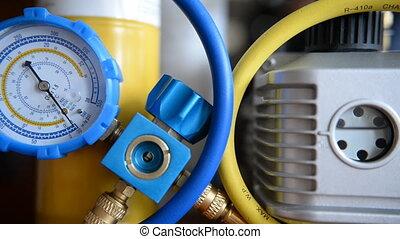 HVAC Repair Close-Up Vacuum pump, pressure gauge, manifold for Repair and Installation of refrigerators, air conditioners, ventilation, heating