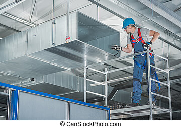 HVAC Technician Testing Newly Installed Warehouse Ventilation System
