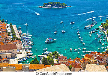 Hvar bay and yachting harbor aerial view