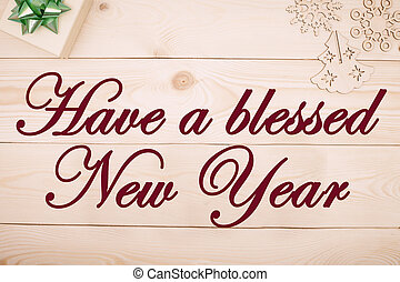 Hve a blessed New Year inscription of dried flowers, a beige...